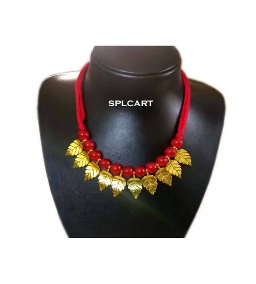 COTTON DORI WITH RED GLASS BEADS AND LEAF CHARMS NECKSET